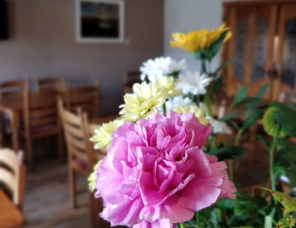 A picture of flowers laid out in our large kitchen and dining area of our Donegal B&B