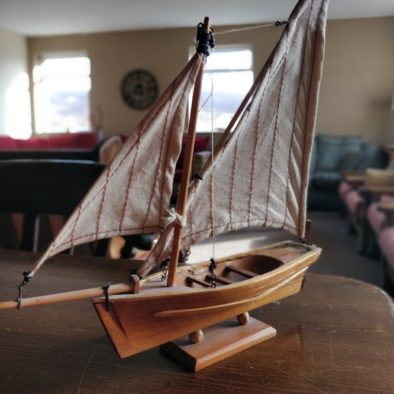 A small wooden boat ornament