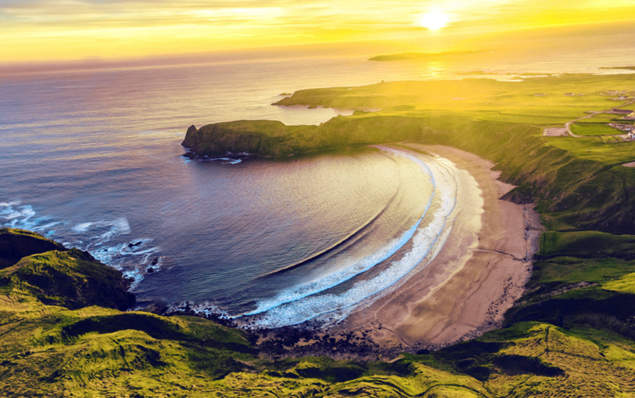 This picture shows a beautiful sunset over SIlver Strand beach, taken from atop the nearby cliff edge